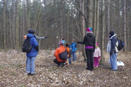 Visitors to a Conservation Park are putting on a bird feeder.