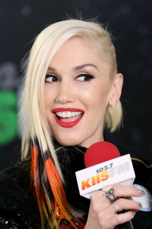 Gwen with orange, black, and yellow highlights