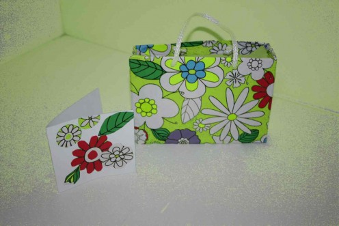 Gift bag is made from old box, wrapping paper and thin soft cotton rope.