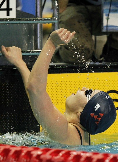 Yuka Kato celebrates as she finishes first after the Japan Swim event in 2012.