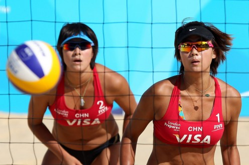 Zhang Xi and Xue Chen play against Greece in a match in 2011.