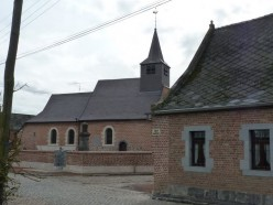 The church of Saint Nicolas of the hamlet of Marchipont which bears the date of its reconstruction (1718).