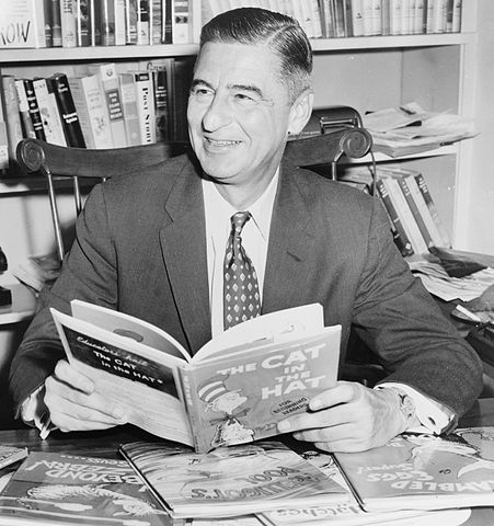 Theodore Geisel (Dr Seuss)l in 1957, holding The Cat in the Hat,