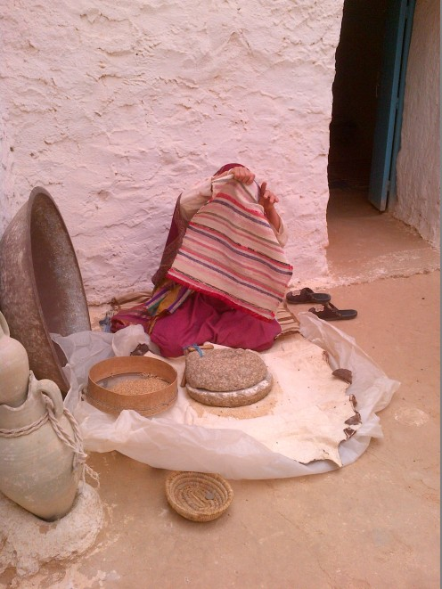 A Tunisian local making bread