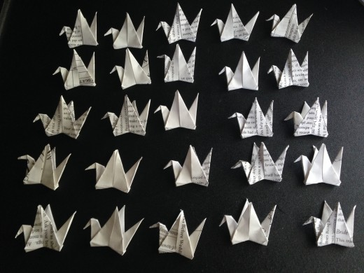 I decided to do 25 cranes per ribbon. I laid them out and made sure their heads and tails were folded correctly.
