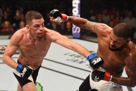 Nate Diaz lands a left punch on Michael Johnson at UFC on Fox 17