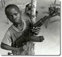 Child soldier with gun