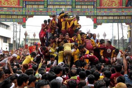 The frenzy and madness of the Festivity of the Black Nazarene.  Philippines.  Photo by Romeo Mariano