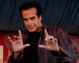 "David Copperfield flashes the ""devil"" horns hand sign."