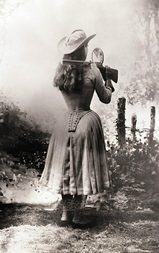 Annie Oakley Shooting Over Her Shoulder with a Handmirror