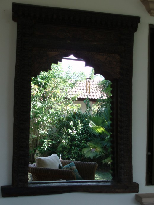 300 years and still going. Beautiful Indian window frame reflecting the garden.