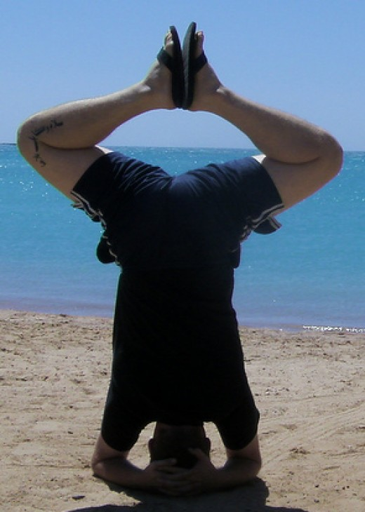 The benefits of headstands go beyond conditioning the neck. They are also a great exercise for balance improvement.