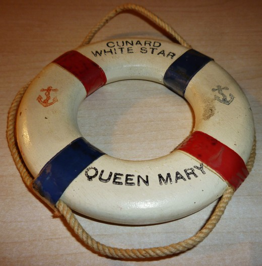 After reading The Lingering Darkness you will understand the reason I included this Queen Mary Ship souvenir.  Amazingly my husband's father returned from service in Europe after the conclusion of World War II on this very ship.