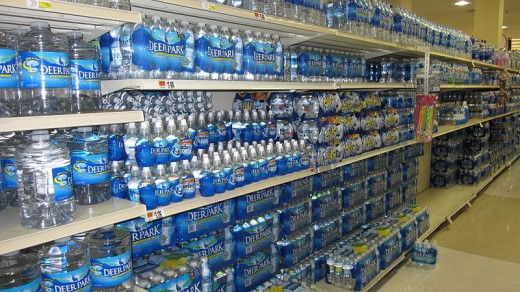 Bottled water fills an aisle in a supermarket