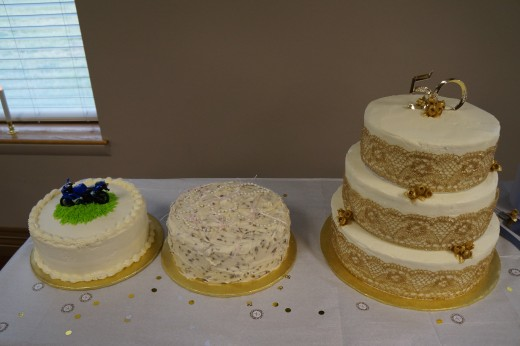 L to R: Groom's cake, Bride's cake (decorated with pearls), Traditional 50th anniversary cake