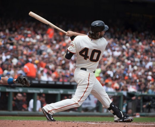 Madison Bumgarner is the pitcher who helps himself while at bat, perhaps more than any other now in Major League Baseball.