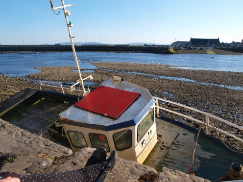 The tide out on the Docks, hence the boat.