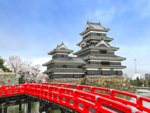 The elegant, unforgettable Matsumoto Castle, with its vermilion red bridge.