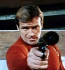 "Ken Clark as Dick Malloy, aka ""077"""
