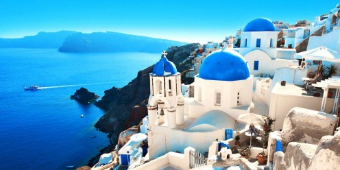 Perched on the rim of a caldera, 980 feet above its port. The stunning views of Santorini with its whitewashed buildings, blue-dome churches and breathtaking views of the surrounding sea and distant islands.