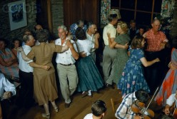 Couples swirl  around a fiddler  at a square dance in 1952.