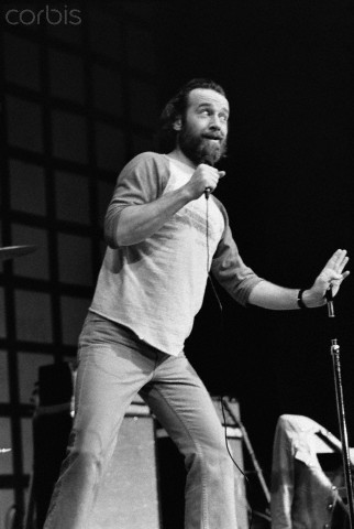 The super-star comedian, George Carlin does a stand-up concert in 1976.