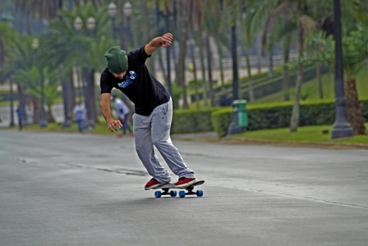 A man practicing skateboarding.