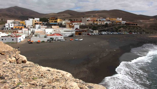 The volcanic black sand beach and village of Ajuy, an isolated and quite picturesque little fishing community on the  west coast of Fuerteventura