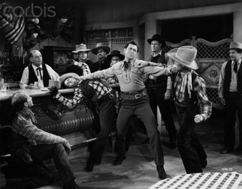 "Causing brawls in bars to interact with people. Note: this is from the film, ""Boss of Bullion,"" 1940."