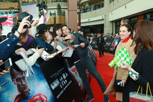 Ben Affleck,, takes a selfie with a fan on the red carpet for a fan engagement event being held at Indigo Mall in Beijing, China