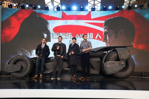 Zack Snyder (far left), director of Warner Bros. Pictures' Batman v Superman: Dawn of Justice, unveils the sleek new Batmobile onstage with (left to right) Ben Affleck, Chinese Spectator Ambassador Li Yifeng, and Henry Cavill