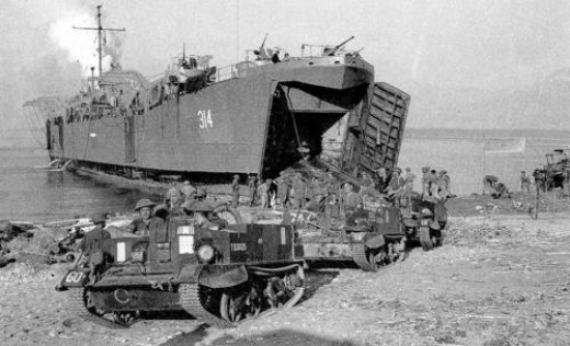 X Corps land scout cars on Salerno beach