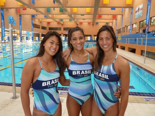 Tatiane Sakemi (left) is with a few of her team mates at the 2011 Pan American Games. Fabiola Molina is on the far right. On all of their suits are the words Pan 2011. This is a symbol of great pride!