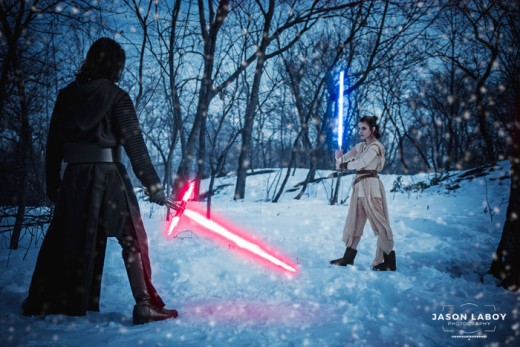 Cosplay actors dressed up as Rey and Kylo Ren reenacting the light saber battle scene