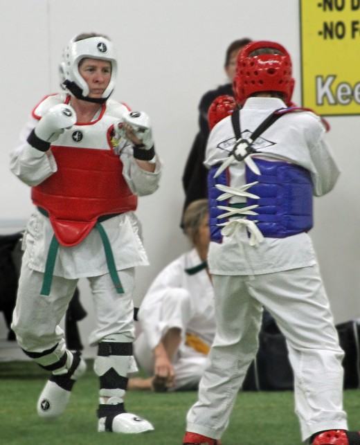 I won my first sparring competition in sudden death with a front jump kick - despite falling on my rear end after executing the kick! :-) See the video below.