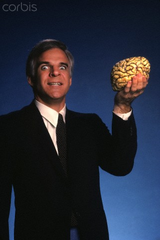 "Martin holds ""human brain,"" to promote his film, ""The Man With Two Brains."""