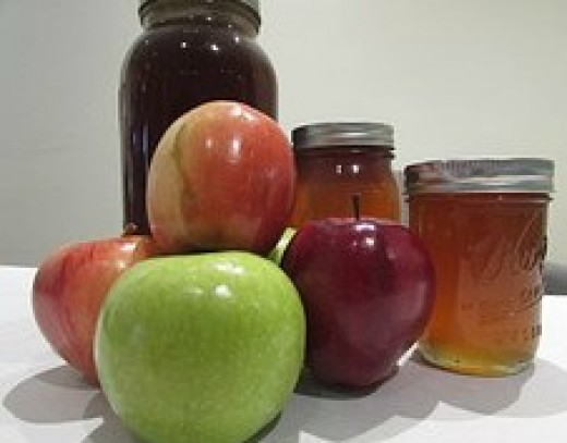 Granny Smith, Red Delicious and Gala apples and Honey
