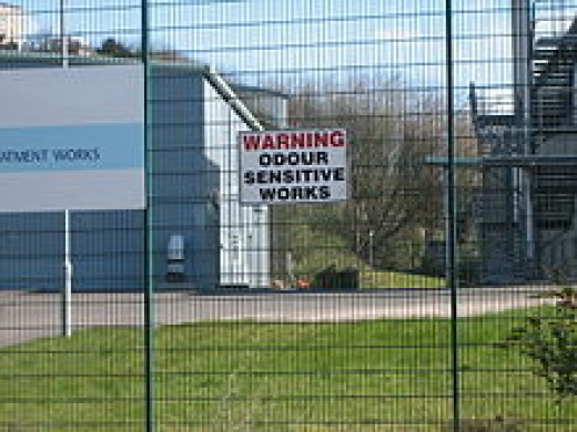 A politically correct sign on a fence.
