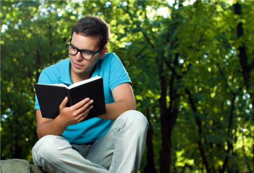 A person reading some book under a tree. Source:veryshareimg.com