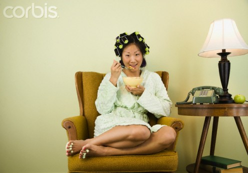 Today, every race and nationality enjoy breakfast cereal such as this pretty Asian woman.
