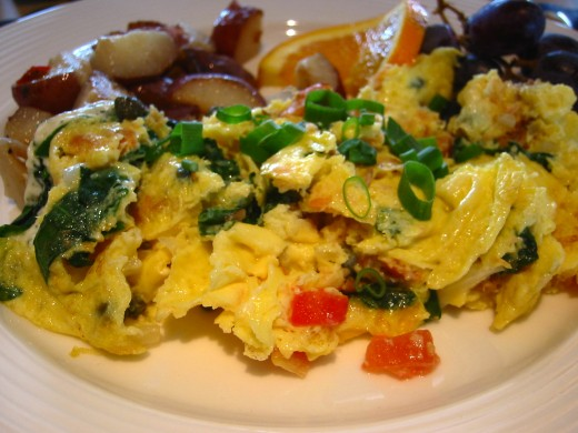 Hot-smoked salmon mixed with scrambled eggs, tomatoes, capers and cream cheese; tastes amazing.