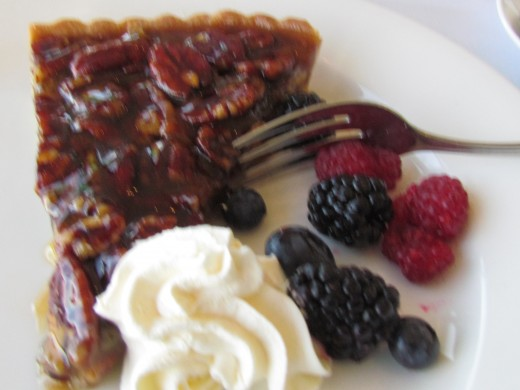 A delicious slice of Pecan Pie with whipped cream, black berries and raspberries was served for dessert.
