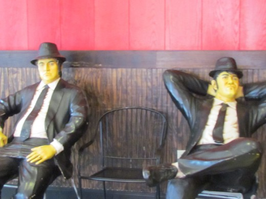 Statues of the Blues Brothers, rests on the bench outside of Fridays, as part of the Rainforest experience.