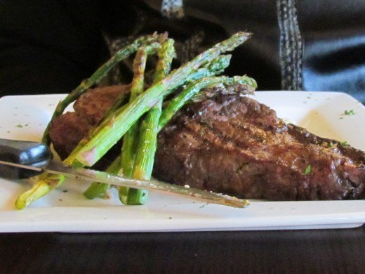 My husband Walker, ordered the New York Strip Steak with asparagus and a glass of red wine.
