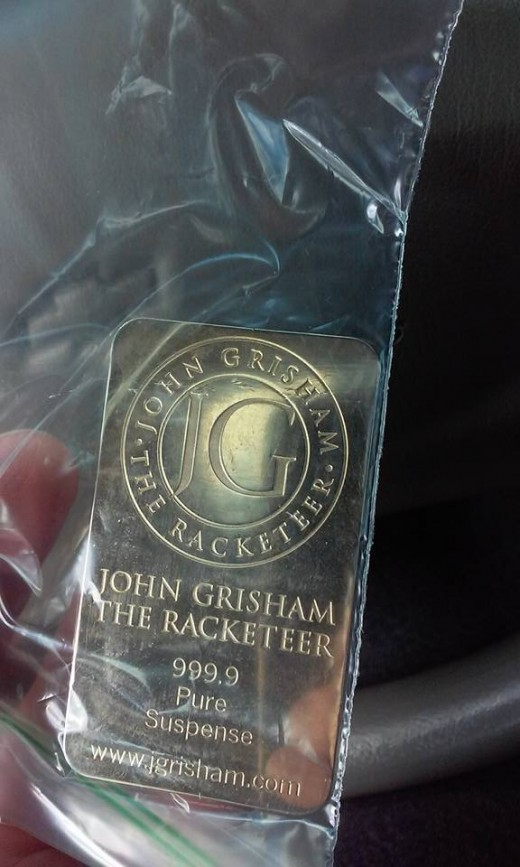 "This ""John Grisham: The Racketeer"" Geo-coin is on a mission to find the West Coast!"