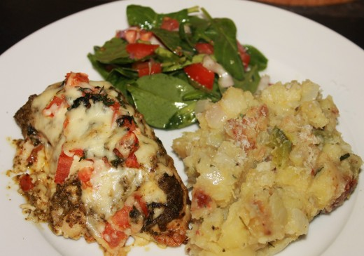 Baked Pesto Chicken with Potato Green Pepper Hash and a side spinach salad