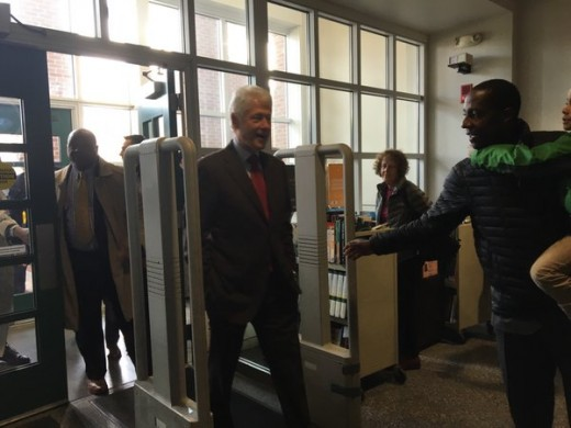 Clinton walking into MA polling station during voting hours.