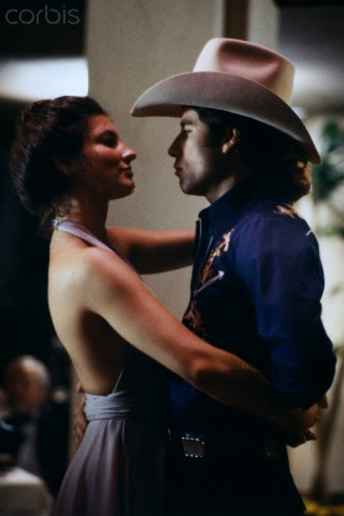 "John Travolta, ""Bud,""  and Madolyn Smith, ""Pam,""  on set of  Urban Cowboy."