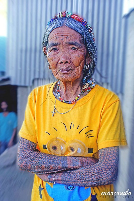 The above photo of a tattooed woman  from Northern Philippines resembles the tattoo of the ancient Pintados.  Photo by Mark Wynn Orca Combo, COEP.