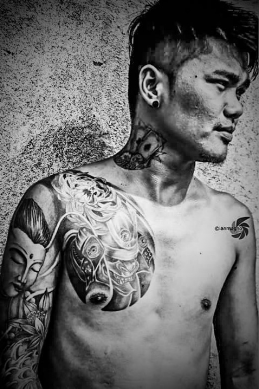 Arm and breast tattoo.  Photo by Aldrian Mejia Magno, COEP.